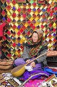 Ashgabat, Turkmenistan - March 9.  Portrait Of Unidentified  Asian Woman With Dutar. Woman  Sells Na