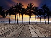 Old Wood Terrace On Sea Beach With Coconuts Tree And Beautiful Dusky Sky Behind Use For Multipurpose