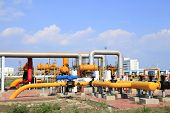 foto of oilfield  - In oil field there is oil pipeline and oilfield equipment at work - JPG