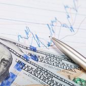 100 Usa Dollars Banknote With Pen Over Stock Market Chart - Studio Shot