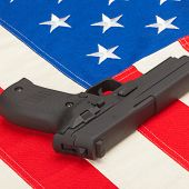 Handgun Laying Over Usa Flag - Studio Shoot