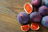 Fresh figs on wooden background
