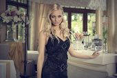 Elegant Blond Girl At The Restaurant