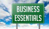Business Essentials on Highway Signpost.