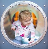 Adorable Funny Baby Girl Hiding On A Playground