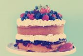 Sponge Layer Cake With Fresh Whipped Cream, Raspberry Jelly And Raspberries, Strawberries And Bluebe