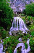 Waterfall at St. Beatus Caves on Lake Thun (Switzerland)