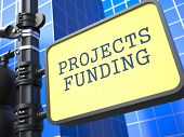 Projects Funding. Signpost on Blue Background.