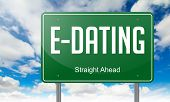 E-Dating on Highway Signpost.