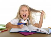 Sweet Little School Girl Pulling Her Blonde Hair In Stress Getting Crazy While Studying