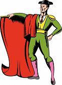 Matador bullfighter standing with cape