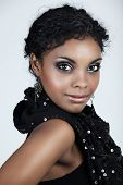 image of black curly hair  - Beautiful African woman with with smoky eyeshadows in party sequin dress - JPG