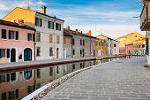 foto of ferrara  - Colorful houses at twilight along a canal in Comacchio - JPG
