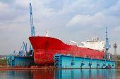 Big Red Tanker Under Repairing In Blue Floating Dock, Varna