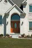 pic of front door  - beautiful front door entrance to this new white brick home - JPG