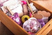 stock photo of arts crafts  - Scrapbooking craft materials in a wooden box - JPG