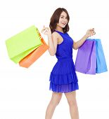Smiling Young Woman Walking And  Holding Shopping Bags