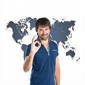 Man Making Ok Sign Over Atlas Background