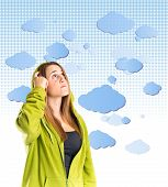 Young Girl Thinking Over Sky Background
