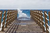 stock photo of trestle bridge  - Bridge on beach extended into the sea