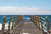 stock photo of trestle bridge  - Bridge on beach extended into the sea - JPG