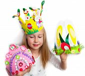Little girl demonstrating her cruft works, Easter bonnets