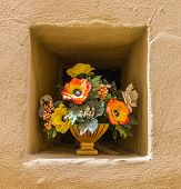 Yeloow Wall Niche With A Pot Of Flowers