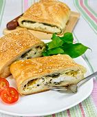 Roll Filled With Spinach And Cheese On Tablecloth