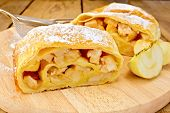 Strudel With Apples And Strainer On Board