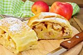 Strudel With Apples And Napkin On Board