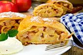 Strudel With Apples In Bowl With Ice Cream On Board