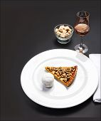 Pumpkin Pie With Whipped Cream. Slice Of Squash Pie  On A Black Background With Copyspace For Your T