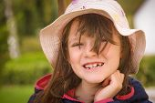 Pretty Young Girl Showing Her Missing Upper Tooth
