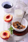Granola and oat mash with fresh blueberries, nectarines