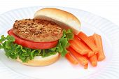 stock photo of veggie burger  - Delicious soy based vegan burger with fresh vegetables - JPG
