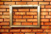 Vintage Wooden Frame For Pictures On Old Brick Wall