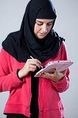 Arab Girl Using Tablet
