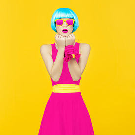 stock photo of swagger  - Glamorous lady bright style on yellow background - JPG