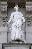 GRAZ, AUSTRIA - JANUARY 10, 2015: Statue of Commerce, allegorical representation, detail of Rathaus Town Hall, Graz, Styria, Austria on January 10, 2015.