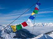 Prayer flag in front of peaks