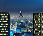Businessman thinking going the tightrope