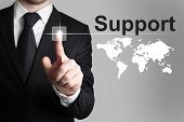 Businessman Pushing Button Support Worldmap International
