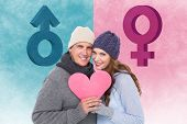 Happy couple in warm clothing holding heart against female gender symbol