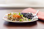 stock photo of scallion  - Healthy nutty Quinoa and Carrot Salad and scallions with black beans  - JPG
