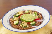 foto of tabouleh  - Red Quinoa Tabbouleh salad with juicy grilled chicken and cucumbers with chopped parsley - JPG
