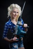 pin-up blonde with industrial hammer.