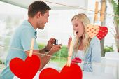 pic of marriage proposal  - Man proposing marriage to his shocked blonde girlfriend against hearts hanging on the line - JPG