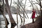 Blonde in Red Scarf Near the River in Winter