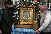 MIKULCICE, CZECH REPUBLIC - MAY 25, 2013: Orthodox believers carry a miracle-working icon of the Virgin Eleusa at an orthodox service in honour of St Cyril and Methodius in Mikulcice, Czech Republic.