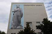 PRAGUE, CZECH REPUBLIC - JUNE 13, 2014: Banner depicted Russian president Vladimir Putin dressed as Soviet dictator Josef Stalin and with Adolf Hitler moustache on the DOX Centre in Prague, Czech Rep.